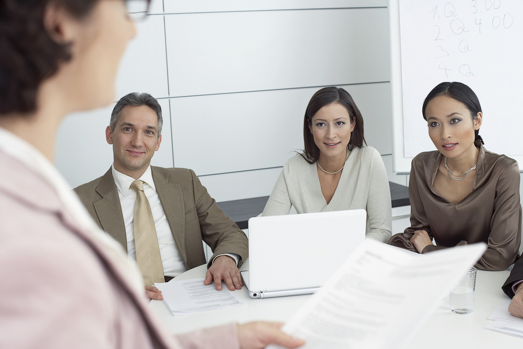 Co-workers in a meeting --- Image by © Nic Ortega/Corbis