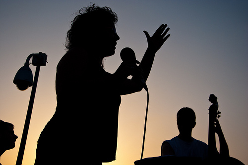 silhouette-of-a-woman-singing